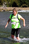 NELSON LAKES, NEW ZEALAND - APRIL 18:  Yvette Mortimer crosses the Travers River during the 2015 Alpine Lodge Loop The Lake trail run at Lake Rotoiti on April 18 16, 2015 in Nelson, New Zealand. (Photo by Marc Palmano/Shuttersport Limited)