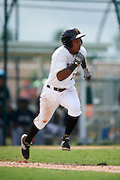 GCL Pirates outfielder Victor Fernandez (23) runs to first during the first game of a doubleheader against the GCL Yankees 2 on July 31, 2015 at the Pirate City in Bradenton, Florida.  GCL Pirates defeated the GCL Yankees 2 2-1.  (Mike Janes/Four Seam Images)