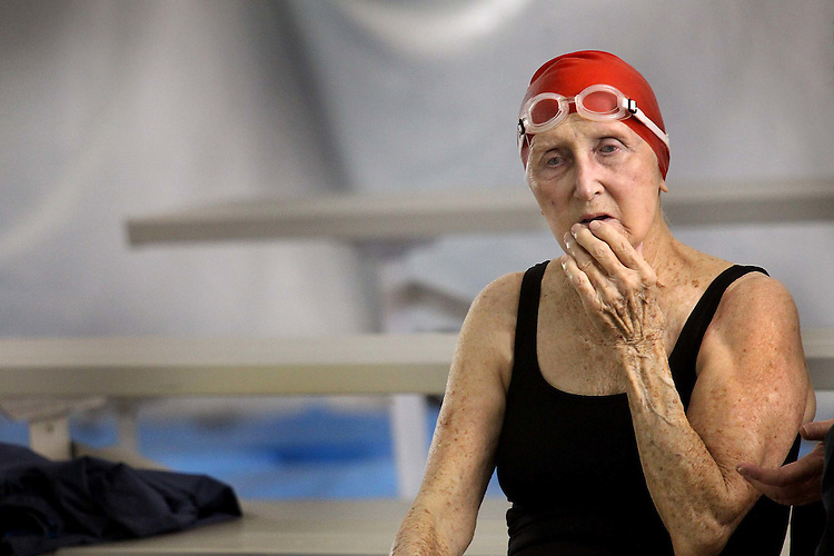 Chuck Beckley/ The Sun Journal   Irma McQuade, 92, takes a moment to reflect on her up coming 500 yard freestyle race as part of the Senior Games. She completed her twenty laps in 30 minutes.