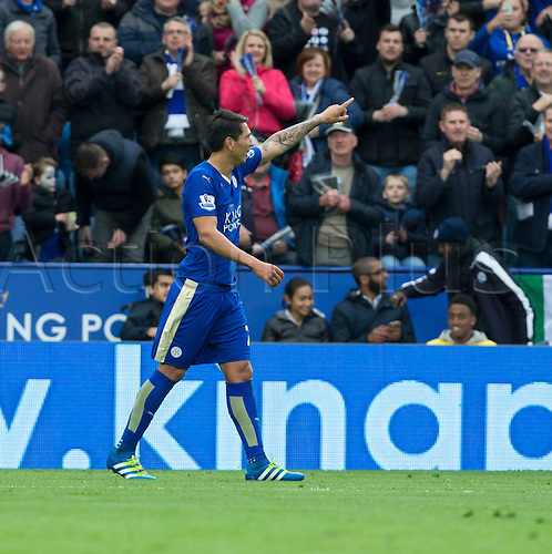 24.04.2016. King Power Stadium, Leicester, England. Barclays Premier League. Leicester versus Swansea.  Leonardo Ulloa raises his arm pointing to the team dug out after he scored in the 60th minute.
