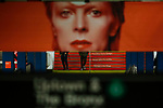 NEW YORK - APRIL 20: People walk at a subway station while images of David Bowie are displayed as art installations on April 20, 2018 in New York, NY. A Bowie exhibition inside Broadway-Lafayette subway station features fan-made works of Bowie-themed art paying tribute to one of rock's most iconic figures in New York City. The Bowie installation at Broadway-Lafayette is a collaboration between Spotify and the Brooklyn Museum. (Photo by Eduardo MunozAlvarez/VIEWpress)