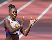 Dina ASHER-SMITH of GBR crosses the line during the heats and celebrates breaking the British 100m record in a time of 10.99 during the Sainsburys Anniversary Games at the Olympic Park, London, England on 25 July 2015. Photo by Andy Rowland.