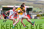 Liam Móinséil, Castlegregory, in possession of the ball tackled by An Ghaeltacht Cian Ó Murchú and Marc Ó Sé during the West Kerry Championship match in Pairc an Aghasaigh, Dingle, on Sunday afternoon.