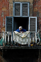 An elderly woman at her home in Trastevere.