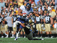 SEPTEMBER 10 2011: California Golden Bears wide receiver Marvin Jones (1) is tackled by Colorado Buffaloes defensive back Ray Polk (26) during a non-conference game with two PAC 12 teams between the Californa Golden Bears and the University of Colorado Buffaloes at Folsom Field in Boulder, Colorado. The Golden Bears beat the Buffaloes 36-33 in overtime.  *****For editorial use only*****