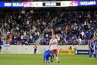 Tim Ream (5) of the New York Red Bulls comforts Teal Bunbury (9) of the Kansas City Wizards after the game. The New York Red Bulls defeated the Kansas City Wizards 1-0 during a Major League Soccer (MLS) match at Red Bull Arena in Harrison, NJ, on October 02, 2010.
