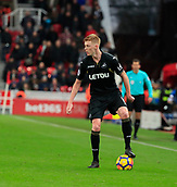 2nd December 2017, bet365 Stadium, Stoke-on-Trent, England; EPL Premier League football, Stoke City versus Swansea City; Sam Clucas of Swansea City tries to move the ball forward