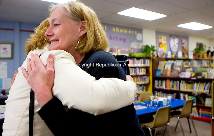OXFORD, CT- 17 MAY 2007- 051707JT02- <br /> Oxford Library head librarian Lois Hiller hugs library patron Lisa Low at the library on Thursday during a going away party for Hiller, who is leaving to work in Groton.<br /> Josalee Thrift Republican-American