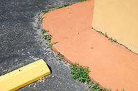 An orange and yellow curb is seen in a parking lot in Hialeah, Florida, on Sun., Oct. 9, 2016.