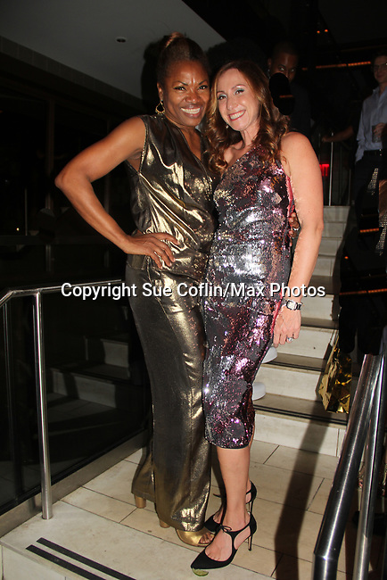 Deborah Koenigsberger & friend - Hearts of Gold annual All That Glitters Gala - 24 years of support to New York City's homeless mothers and their children - (VIP Reception - Silent Auction) was held on November 7, 2018 at Noir et Blanc and the 40/40 Club in New York City, New York.  (Photo by Sue Coflin/Max Photo)