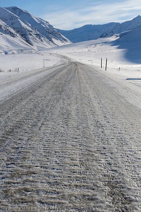 Ice covers the James Dalton Highway in Atigun Canyon, Brooks Range, Arctic, Alaska.