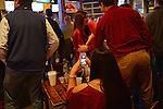 A girl scans through her Facebook feed full of friends dressed in University of Alabama gear during the College Football Bowl Championship Series, BCS, final at Moe's Barbeque on University Boulevard in downtown Tuscaloosa, Alabama on January 7, 2013.  Alabama beat Notre Dame 42-14.