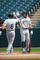 Akron RubberDucks Todd Hankins (8) is congratulated at home by Taylor Murphy (11) after hitting a home run during the second game of a doubleheader against the Bowie Baysox on June 5, 2016 at Prince George's Stadium in Bowie, Maryland.  Bowie defeated Akron 12-7.  (Mike Janes/Four Seam Images)
