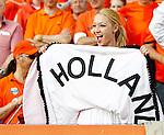 Nederland, Rotterdam, 30 mei 2012.Oefeninterland .Nederland-Slowakije .Een supporter van Nederland toont een jurk met de tekst: 'holland'.