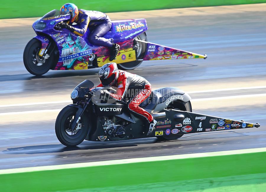 Oct 17, 2015; Ennis, TX, USA; NHRA pro stock motorcycle rider Matt Smith (near) races alongside L.E. Tonglet during qualifying for the Fall Nationals at the Texas Motorplex. Mandatory Credit: Mark J. Rebilas-USA TODAY Sports