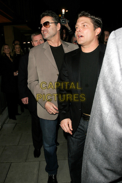 GEORGE MICHAEL & KENNY GOSS.Linda McCartney photographs - private view, James Hyman Gallery, London, England..April 23rd, 2008.photographic photo exhibition full length black jacket grey gray sunglasses shades couple stubble facial hair .CAP/AH.©Adam Houghton/Capital Pictures.