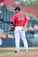Richmond Flying Squirrels relief pitcher Pedro Rodriguez (50) looks to his catcher for the sign against the Bowie Baysox at The Diamond on May 24, 2015 in Richmond, Virginia.  The Flying Squirrels defeated the Baysox 5-2.  (Brian Westerholt/Four Seam Images)