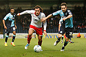 Lawrie Wilson of Stevenage and John Halls of Wycombe challenge. - Wycombe Wanderers v Stevenage - Adams Park, High Wycombe - 31st December 2011  .© Kevin Coleman 2011