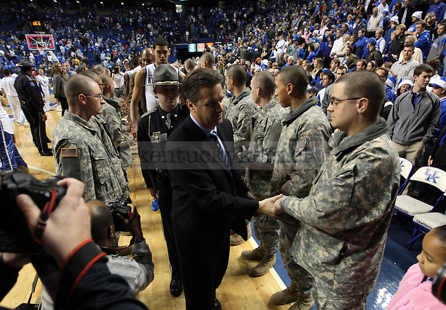 UK head coach John Calipari shakes hands with soldiers after the second half of the UK's win over Winthrop Dec. 22, 2010. Photo by Britney McIntosh | Staff