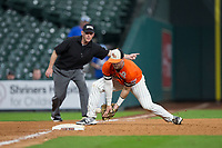 Sam Houston State Bearkats third baseman Ben Haefner (6) can't make the play as third base umpire David Frame signals fair ball during the game against the Mississippi State Bulldogs in game eight of the 2018 Shriners Hospitals for Children College Classic at Minute Maid Park on March 3, 2018 in Houston, Texas.  The Bulldogs defeated the Bearkats 4-1.  (Brian Westerholt/Four Seam Images)