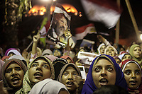 In this Thursday, Aug. 01, 2013 photo, female supporters of the ousted president Mohammed Morsi chant slogans during a demonstration after prayers at the sit-in of Cairo University, in the Giza district. (Photo/Narciso Contreras).