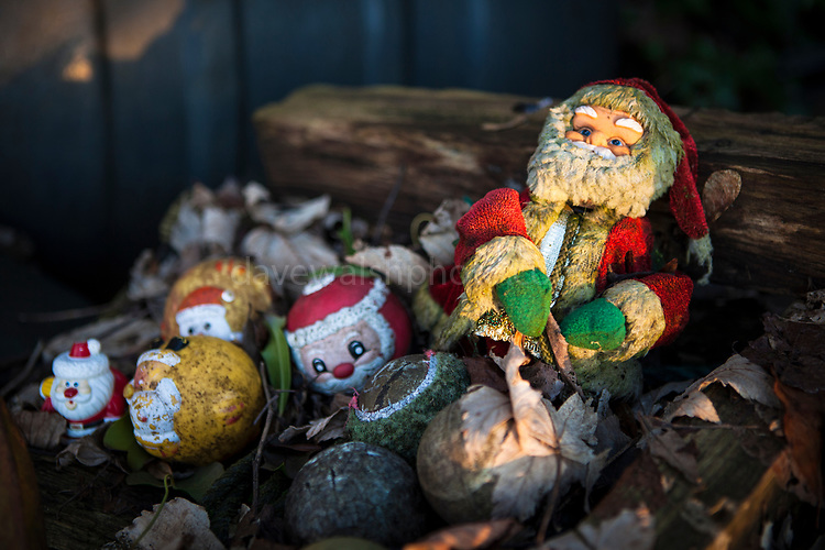 Santa Claus and abandoned Christmas toys washed up on beach