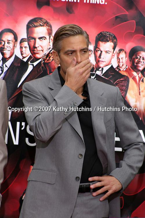 George Clooney.Handprint & Footprint Ceremony For Ocean's Thirteen's.George Clooney, Brad Pitt, Matt Damon, and Jerry Weintraub.Gruman's Chinese Theater.Los Angeles, CA.June 5, 2007.©2007 Kathy Hutchins / Hutchins Photo....