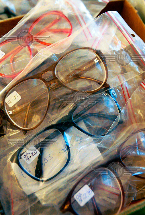 Glasses donated by the Scandinavian NGO Vision for All. The charity collects old glasses for use in the developing world. Teams of student opticians visit rural villages setting up eye clinics, prescribing and handing out the appropriate glasses.