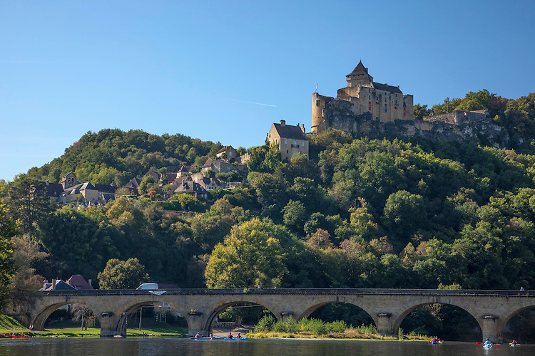 The Dordogne River flows serenely past French and British medieval castles and villages in south west France.