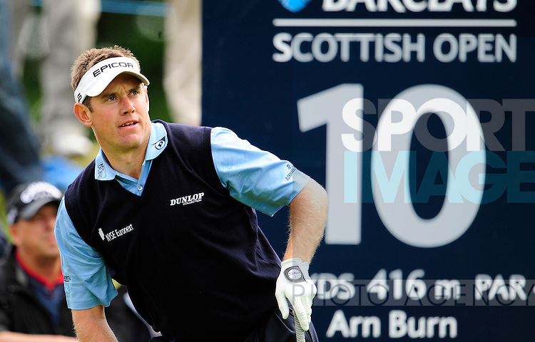 Lee Westwood of England folows the flight of his drive on the 10th