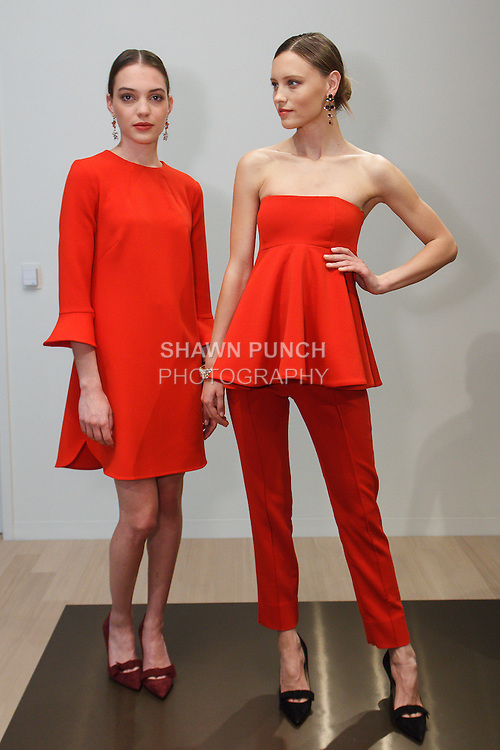 Models pose in outfits from the Ann Taylor Fall Winter 2016 collection by Austyn Zung, at 7 Times Square on April 20, 2016.