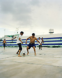 MEXICO, Maya Riviera, Yucatan Peninsula, young men play soccer in the town of Akumal