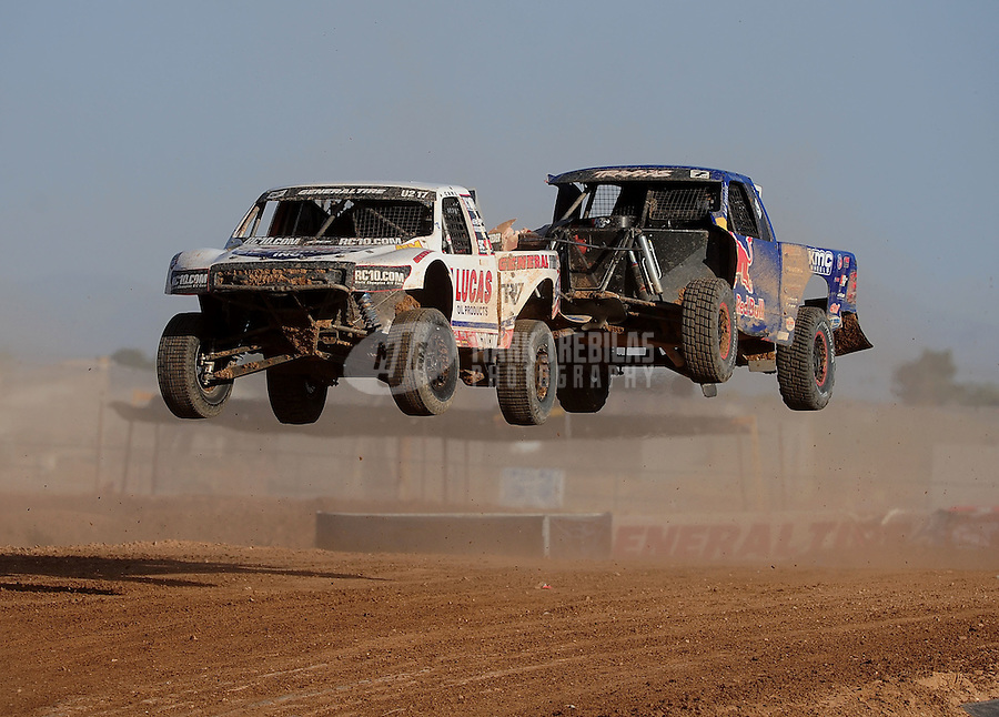 Apr 17, 2011; Surprise, AZ USA; LOORRS driver Carl Renezeder (17) leads Bryce Menzies (7) during round 4 at Speedworld Off Road Park. Mandatory Credit: Mark J. Rebilas-