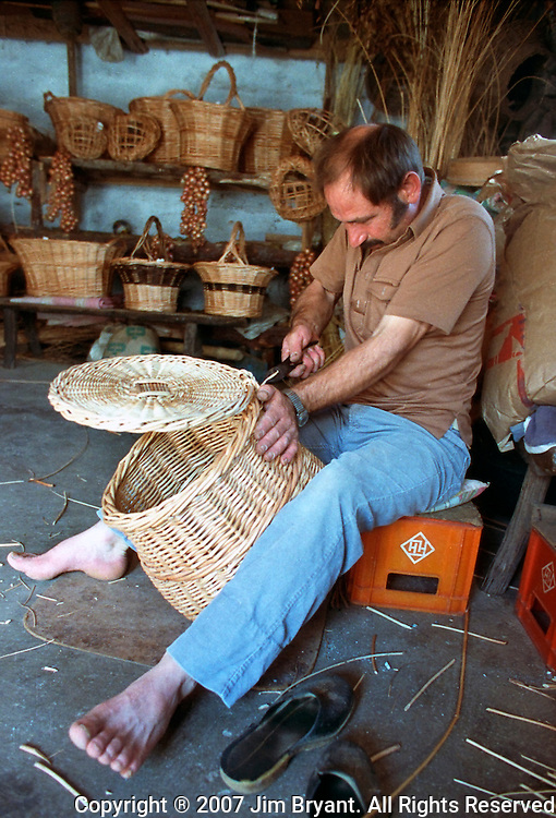A basket takes shape in the hands of a craftsman on Terceira, Azores. The Azoreans are highly skilled craftsman in weaving, ceramic, boat building and their products reflect ingenuity and artistic tastes. Many tools, utensils and farm implements are locally produced and handmade Far out in the Atlantic Ocean, some 850 miles off the western coast of Lisbon, Portugal lies the 425-mile long archipelago of the Azores. (Jim Bryant Photo).....