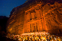 """Petra by night is a romantic affair, walking through the lantern lit gorge (siq) with no other lighting makes you feel like a true explorer.<br /> This ancient site, established possibly as early as 312 BCE as the capital city of the Nabataeans, it is a symbol of Jordan. It lies on the slope of Jebel al-Madhbah (identified by some as the biblical Mount Hor) in a basin among the mountains which form the eastern flank of Arabah (Wadi Araba), the large valley running from the Dead Sea to the Gulf of Aqaba. Petra has been a UNESCO World Heritage Site since 1985. The site remained unknown to the Western world until 1812, when it was introduced by Swiss explorer Johann Ludwig Burckhardt.<br /> UNESCO has described it as """"one of the most precious cultural properties of man's cultural heritage"""". Petra was named amongst the New 7 Wonders of the World in 2007 and was also chosen by the Smithsonian Magazine as one of the """"28 Places to See Before You Die""""."""