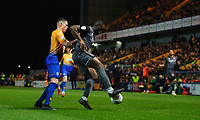 Lincoln City's John Akinde shields the ball from Mansfield Town's Matt Preston<br /> <br /> Photographer Chris Vaughan/CameraSport<br /> <br /> The EFL Sky Bet League Two - Mansfield Town v Lincoln City - Monday 18th March 2019 - Field Mill - Mansfield<br /> <br /> World Copyright © 2019 CameraSport. All rights reserved. 43 Linden Ave. Countesthorpe. Leicester. England. LE8 5PG - Tel: +44 (0) 116 277 4147 - admin@camerasport.com - www.camerasport.com