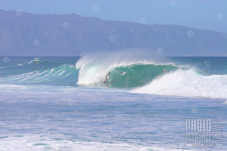 A surfer rides the barrel at Off the Wall on Oahu's North Shore.