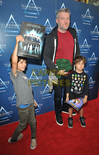"Charlie Brooker with his sons Huxley Brooker Huq, Covey Brooker Huq at the ""The Illusionists"" show press night, Shaftesbury Theatre, Shaftesbury Avenue, London, England, UK, on Wednesday 10th July 2019.<br /> CAP/CAN<br /> ©CAN/Capital Pictures"
