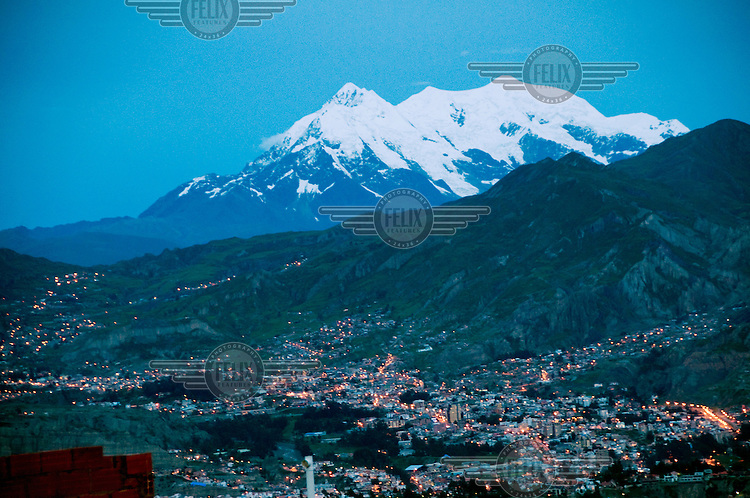 Mount Illimani looms over La Paz.