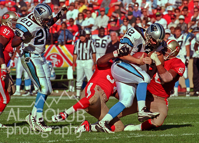 San Francisco 49ers vs. Carolina Panthers at Candlestick Park Sunday, November 5, 1995.  Panthers beat 49ers  13-7.  San Francisco 49ers linebacker Rickey Jackson (57) and defensive end Dennis Brown (96) sack Carolina Panthers quarterback Kerry Collins (12).