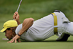 7 September 2008:    Camilo Villegas does his signature balancing act to check his putt in the fourth and final round of play at the BMW Golf Championship at Bellerive Country Club in Town & Country, Missouri, a suburb of St. Louis, Missouri on Sunday September 7, 2008. The BMW Championship is the third event of the PGA's  Fed Ex Cup Tour.