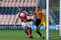 Callum Reynolds of Barnet clears off the line under pressure from Ched Evans of Fleetwood Town during Barnet vs Fleetwood Town, Emirates FA Cup Football at the Hive Stadium on 10th November 2019