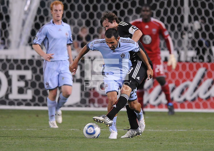 Colorado Rapids midfielder Pablo Mastroeni  (25) fights for possession of the ball against DC United defender Carey Talley (8). The Colorado Rapids defeated DC United 1-0 at RFK Stadium, Saturday May 15, 2010.