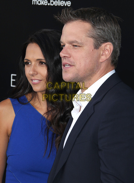Luciana Barroso, Matt Damon<br /> &quot;Elysium&quot; Los Angeles Premiere held at the Regency Village Theatre, Westwood, California, UK,<br /> 7th August 2013.<br /> portrait headshot side profile   blue navy suit white shirt dress married couple husband wife <br /> CAP/ADM/RE<br /> &copy;Russ Elliot/AdMedia/Capital Pictures