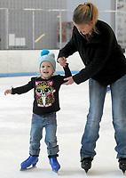 NWA Democrat-Gazette/DAVID GOTTSCHALK  Viola Johnson, 3, skates with her mother Sara Friday, March 23, 2018, during the Frozen Friday skating event at the Jones Center in Springdale. Animated movie princess characters Elsa and Anna visited with skaters as part of the Spring Break Week 2018  activities at the center.
