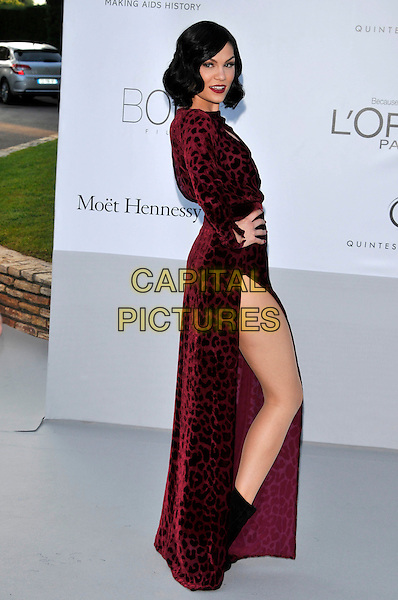 Jessie J (Jessica Ellen Cornish).AmFAR Cinema Against AIDS 2012, Hotel du Cap, Antibes during the 65th  Cannes Film Festival, France..24th May 2012.full length red maroon burgundy cut out away slit split ankle boots leopard print animal hand on hip side .CAP/PL.©Phil Loftus/Capital Pictures.