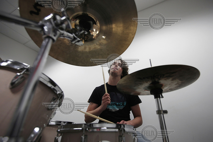 A student practices drumming in the music studios at the Brit School, in Croydon. The Brit is Britain's only non-fee paying performing arts and technology school.