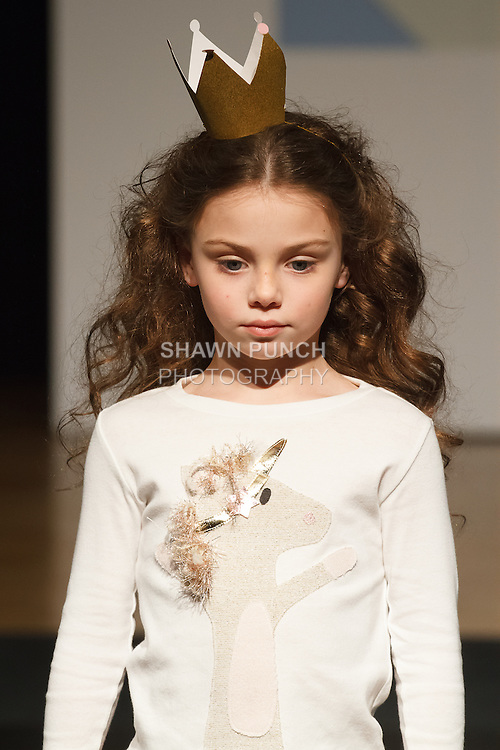 Model walks runway in an outfit by Oh Baby!, during the petitePARADE Children's Club fashion show at the Jacob Javits Center in New York City, on January 9, 2016.