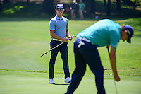 Brandon Stone (RSA) celebrates his chip in on 1 as Emiliano Grillo (ARG) laughs during round 1 of the World Golf Championships, Mexico, Club De Golf Chapultepec, Mexico City, Mexico. 3/2/2017.<br />