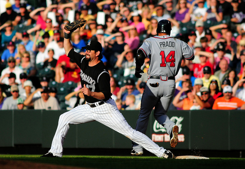 July 9, 2009: Rockies 1st baseman Todd Helton reaches for the throw as Braves 3rd baseman Martin Prado crosses the bag during a regular season game between the Atlanta Braves and the Colorado Rockies at Coors Field in Denver, Colorado.